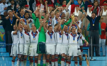 56.+Germany's+players+celebrate+with+the+World+Cup+trophy+after+the+2014+World+Cup+final+against+Argentina.+Reuters